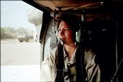 Griego waits for a helicopter to take off while serving in Iraq,