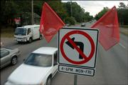 Motorists pass a no-left turn sign at 23rd and Ohio streets. Left turns are banned between 4 p.m. and 6 p.m. on select streets intersecting 23rd Street.