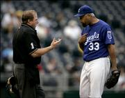 Home-plate umpire Bruce Deckman, left, talks to Kansas City starter Jose Lima after Lima struck out Detroit's Chris Shelton in the ninth inning of the second game of a doubleheader. Lima pitched a complete game, but the Royals fell, 1-0, in Game Two on Sunday in Kansas City, Mo. Kansas City lost the opener, too, 8-7.