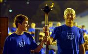 Fifth-generation Jayhawks Drew Miller, from Iola, left, and Richie Wagstaff, from Prairie Village, are part of the Passing of the Torch ceremony during Traditions Night 2005 at Memorial Stadium.