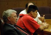 Adan Cruz, 23, in orange jumpsuit, is sentenced for his role in the April 9 death of Jodie Hatzenbihler, a 25-year-old nurse from Olathe. Cruz was driving under the influence of alcohol when his car struck Hatzenbihler, who was crossing the street with friends after leaving the Cadillac Ranch, 2515 W. Sixth St. At left is Cruz's attorney, Shelley Bock.