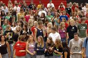 The Lawrence High School sophomore class participates in orientation exercises in the school's gym.