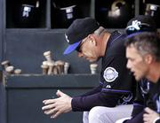 Kansas City manager Buddy Bell sits in the dugout during the final moments of the Royals' game against Seattle. The Mariners beat the Royals, 11-5, Wednesday in Seattle, handing K.C. its 18th straight loss.