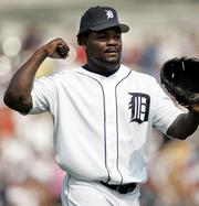 Detroit closer Fernando Rodney celebrates after getting Boston's David Ortiz to hit into a game-ending double play. The Tigers defeated the Red Sox, 6-5, Wednesday in Detroit.