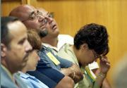 Members of the Otero family listen to testimony in the first day of the sentencing phase in the trial of confessed BTK serial killer Dennis Rader in Wichita, as officials described the murders of four of their family members in 1974. Rader pleaded guilty this summer to 10 Wichita-area murders over a 30-year span.