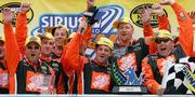 NASCAR driver Tony Stewart, center, and his pit crew celebrate his victory in the Sirius at the Glen. Stewart earned his fifth victory of the season Sunday in Watkins Glen, N.Y.