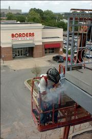 Brian Paulsen, of Harris Construction Co. Inc. in Lawrence, welds a railing at Hobbs Taylor Lofts, 730 N.H. To learn more about the condo, office and commercial project - and how it will affect nearby businesses - watch 6News at 10 p.m. Sunday on Sunflower Broadband Channel 6 and see Monday's Journal-World.