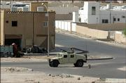 A Jordanian military vehicle stands guard in Aqaba Friday after unknown attackers fired at least three missiles, killing a Jordanian soldier. The missiles were believed to have been fired from a neighborhood on the outskirts of Aqaba.