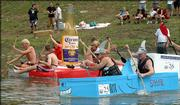 Boaters paddle their cardboard boats at the starting line of the Saturday's boat race at Clinton Lake. Thirty-three boats were entered in the Lawrence Cardboard Boat Race to benefit Leadership Lawrence.
