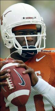 Texas quarterback Vince Young warms up before a game last season. Young and the Longhorns were tapped No. 2 Saturday in the Associated Press preseason Top 25.