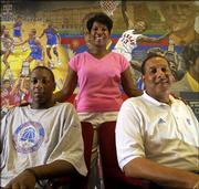 The Chalmers family, from left, freshman guard Mario, mother Almarie and new Kansas University director of basketball operations Ronnie, is a new addition to Jayhawk athletics. The family recently relocated to Lawrence from Anchorage, Alaska.