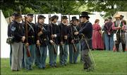 Civil War reenactors drill at an encampment at South Park on Saturday. The encampment was part of the Civil War on the Western Frontier events that showed life in Lawrence and included various demonstrations.