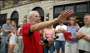 John Jewell, of the Watkins Community Museum, above, talks Saturday about William Quantrill's raid on Lawrence during a walking tour of sites involved in the raid. Jewell is in front of the Eldridge Hotel, which originally was the Free State Hotel and was burned down by Quantrill in the raid.