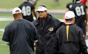 Missouri football coach Gary Pinkel, center, talks to his assistants during practice. Pinkel, shown Monday in Columbia, Mo., is targeted in a lawsuit filed by the family of Aaron O'Neal, a Tiger player who died after a workout last month.
