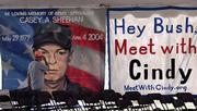 Dan Rueffert, from San Miguel De Allende, Mexico, looks Tuesday at a banner of Casey A. Sheehan that hangs at Cindy Sheehan's anti-war camp near President Bush's ranch near Crawford, Texas.