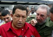 Venezuelan President Hugo Chavez and Cuban President Fidel Castro speak with the media Tuesday minutes before Chavez left for Jamaica at Jose Marti international airport in Havana, Cuba.