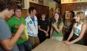 From left, Phil Ozorkiewicz, 17, Brian Ozorkiewicz, 19, Kevin Ozorkiewicz, 21, Matt Miller, 12, Melodie Miller, 15, Joe Ozorkiewicz, Ann Ozorkiewicz and Katie Ozorkiewicz, 15, talk in the Ozorkiewicz kitchen Wednesday evening. Ann and Joe Ozorkiewicz became permanent legal guardians to Matt and Melodie Miller after a Tuesday closed hearing where convicted murderer Martin K. Miller signed away his parental rights. Joe and Ann Ozorkiewicz, longtime family friends of the Millers who have four children of their own, have known Matt and Melodie Miller since birth.