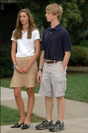 Bishop Seabury Academy students Brooke Sutherland, sophomore, and Justin Esau, junior, are limited in their choice of clothes because of their school's dress code.