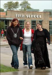 From left, Lawrence High School juniors Audrea Gutierrez, Alease Graff, and Kaileen Shanks like the fact that they can dress pretty much the way they want to when attending school, although LHS has adopted some new guidelines, including not allowing trench coats inside the school. The three were walking to a park during Thursday's lunch break.