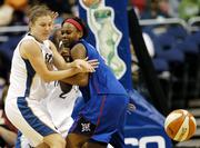 Washington's Laurie Koehn, left, battles for a loose ball with Detroit's Elaine Powell. Koehn, a Kansas State product, had 15 points as the Mystics won, 76-67, Saturday in Washington.