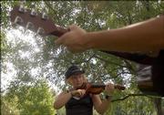 Josephine Michener, 18, works through a tune.