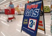Dawn Filkins, Lawrence, shops at Hy-Vee, 4000 W. Sixth St., which offers a daily discount on gasoline with the purchase of groceries. Hy-Vee is among retailers that are boosting sales by offering discounts on gasoline.