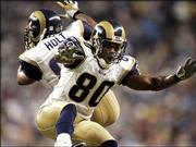 St. Louis receivers Isaac Bruce (80) and Torry Holt celebrate Bruce's 31-yard touchdown catch in the second quarter against Detroit. The Rams beat the Lions, 37-13, Monday in Detroit.