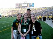 The Karn family, of McClouth, devoted Green Bay Packer fans, traveled earlier this month to Lambeau Field in Green Bay, Wisc., to watch the Packers play the Buffalo Bills. Through special arrangements by Packers head coach Mike Sherman, they watched the game from the sidelines. From left are Tracie, Heidi and Michala Karn. George Karn is in the back.