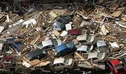 Cars and rubble are seen piled up in an aerial view of wreckage Wednesday from Hurricane Katrina in Long Beach, Miss.