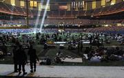 Members of the National Guard stand in the end zone and watch over people who took shelter at the Louisiana Superdome in New Orleans in the aftermath of Hurricane Katrina. With the situation in the smelly and sweltering Superdome becoming ever more desperate, authorities have found a new home for the building's nearly 25,000 hurricane refugees: the Astrodome in Houston.