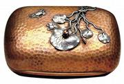 This mixed-metal soap dish by Gorham has brass inside, copper outside and applied lilies, crabs and frogs of copper and silver. The 4-inch-wide piece sold for $1,035 at a James Julia auction in Fairfield, Maine.