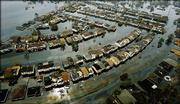 This is an aerial view of a flooded neighborhood Thursday on the east side of New Orleans after Hurricane Katrina passed through the area Monday morning.
