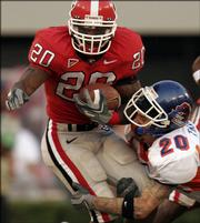 Georgia's Thomas Brown, left, is hit by Boise State's Marty Tadman. The Bulldogs routed the Broncos, 48-13, Saturday in Athens, Ga.