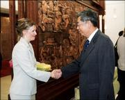 Tanya Dorf, director of Independence Inc. in Lawrence, greets Xu Jialu, the No. 3 official in China's government, during her recent trip to that country.