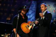 NBC News' Matt Lauer, host of the celebrity telethon for Hurricane Katrina disaster relief, introduces Tim McGraw during the telethon. Some 18 presenters performed musical numbers or gave information on the tragedy's huge scope.