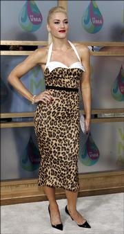 Singer Gwen Stefani poses for photographers as she arrives on the white carpet of the 2005 MTV Video Music Awards at the American Airlines Arena in Miami. Stefani changes stages in September as her L.A.M.B. fashion collection makes its New York Fashion Week debut.