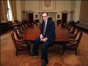 Federal Reserve Board Chairman Alan Greenspan poses in the Board of Governor's room in Washington in 1987, when he was appointed to the position. With Greenspan expected to retire early next year, economists and other Fed watchers are debating what defined the Greenspan era at the central bank and what his legacy will be.