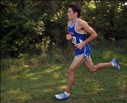 Kansas University's Colby Wissel runs in the Bob Timmons Invitational. Wissel won the men's race Saturday at Rim Rock Farm.