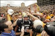 Colorado kicker Mason Crosby celebrates a 31-28 victory over Colorado State.