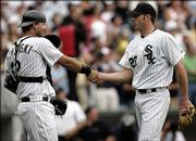 Chicago White Sox starter jon Garland, right, celebrates with catcher A.J. Pierzynski after throwing a complete-game shutout. Garland's performance lifted the White Sox to a 2-0 victory over the Detroit Tigers on Sunday in Chicago.