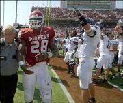 Ailing Oklahoma running back Adrian Peterson leaves the field after a stunning 17-10 loss to TCU