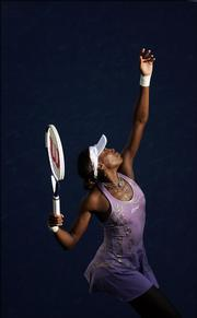 Venus Williams serves to her sister Serena at the U.S. Open. Venus beat Serena in straight sets Sunday in New York.