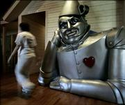 A larger-than-life likenesss of the Tin Man dwarfs a passer-by at the Wizard of Oz Museum in Wamego. The museum, which opened in late 2003, has about 2,000 Wizard of Oz-related items.