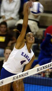 Kansas University's Jana Correa hammers a kill against Saint Louis. The Jayhawks routed the Billikens, 3-0, Tuesday night at Horejsi Center.