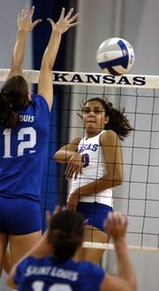 Kansas University's Josi Lima, right, swats a kill past Saint Louis' Lauren Christman. The Jayhawks beat the Billikens, 3-0, Tuesday at Horejsi Center.