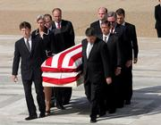 Former clerks including John Roberts, second on right, carry the casket bearing Chief Justice William H. Rehnquist's body to the Supreme Court on Tuesday in Washington.