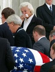 Supreme Court Justice Sandra Day O'Connor, center, watches as the coffin of Chief Justice William Rehnquist is carried into the Great Hall of the Supreme Court in Washington. O'Connor had known Rehnquist since they were classmates at Stanford University's law school more than half a century ago.