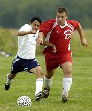 Seabury Academy's Robert Halloran, left, fights for the ball with Englewood Christian's Benjamin Lazea. Seabury won, 4-0, Tuesday at the Youth Sports Inc. fields.