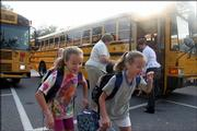 Kids may soon be doing their own griping about rising gas prices, because the problem is affecting schools. One North Carolina school district has canceled field trips, and Newport News, Va., is cutting bus routes. Here, kids take buses to school in Howard County, Md.