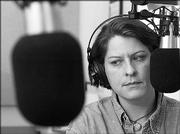 "Laura Lorson listens to a news story on ""All Things Considered"" during her afternoon shift at Kansas Public Radio, 91.5 FM. KPR staff provide local content as well as reports on the statehouse and health issues."
